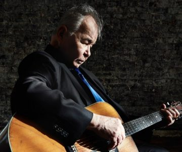 Watch John Prine Search for His Own Records in Nashville, Play Old Classic 'Paradise'